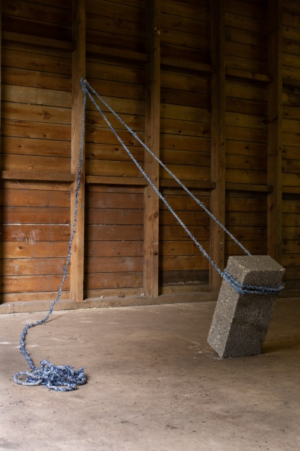 Brace, 2018. Rope made from denim jeans, concrete block.