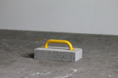 Manhandle, 2020. Concrete block, steel grab handle, metal screws.