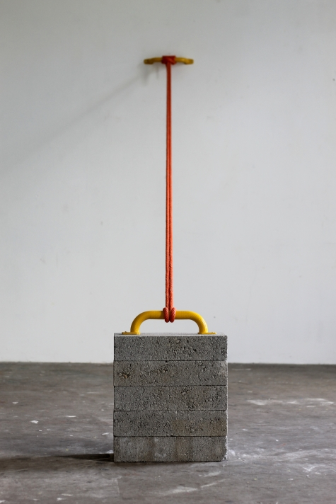 Stack, 2020. Concrete, steel grab handle, metal screws, rope.